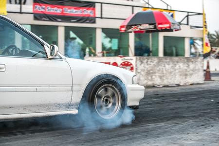 drifting: sport car wheel drifting and smoking on track