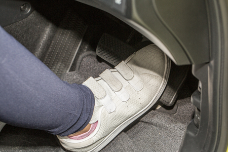 accelerate: foot pressing the accelerate pedal of a car
