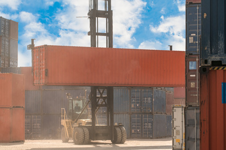 unloading: Loading and unloading of containers in the port on a bright sunny day