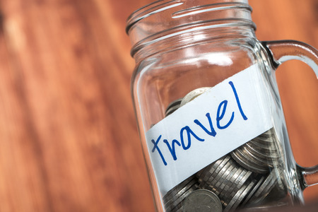 holiday budget: Budget Travel - saving holiday in glass bottles.