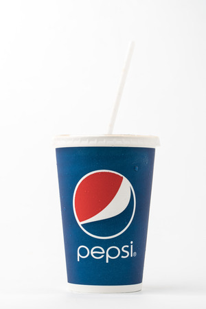 carbonation: Bangkok, Thailand - February 10, 2016: Vintage glass with the logo of Pepsi-old close up. Pepsi is a carbonated soft drink sold in stores, restaurants and vending machines around the world.