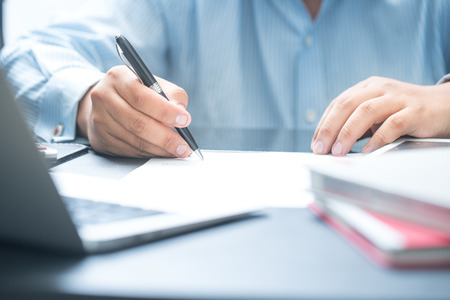 businessman signing documents: Close up businessman signing documents.