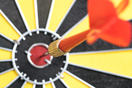dart on target: Closeup dart target with arrow on bullseye, Goal target success business investment financial strategy concept, abstract background Stock Photo