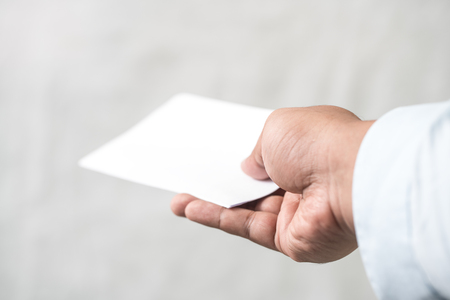 resignation: Hand holding resignation letter Stock Photo