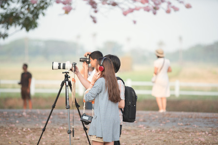 Students young photographer to shoot a picture. Stock Photo