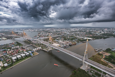 Bhumibol Bridge with storm Stock Photo