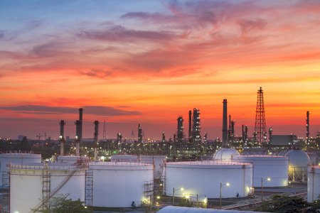 energy use: beautiful lighting of oil refinery plant in heavy petrochemical industry estate use for power ,energy and petroleum industrial topic