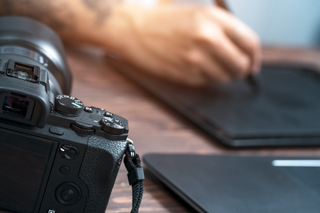 Cropped image of photographer retouching a photo (Focus Camera)