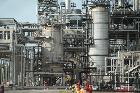 globalwarming: overall view of an oil and gas refinery, pipelines and towers, heavy industry