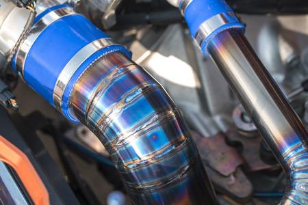 titanium: Welding of titanium pipe. , Titanium tube The engine air intake