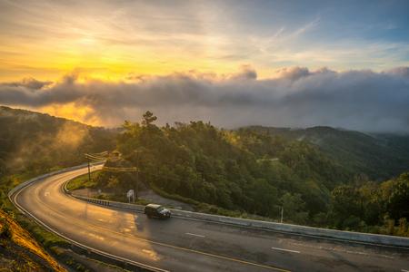 Road view point Mist sunrise in northern, Thailand