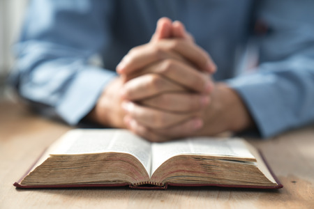 meditation help: An unknown man holding a Bible in her hands and prayed.