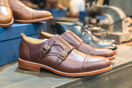 A pair of brown leather shoes with vintage