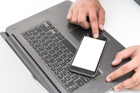 separates: A phone with a screen that separates the desk in the office. Stock Photo