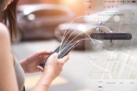 Kuala Lumpur, Malaysia - JUL 17,2016: Joins the MAN Uber app on iPhone 6s. Uber is the smartphone carrier transportation network. Standard-Bild