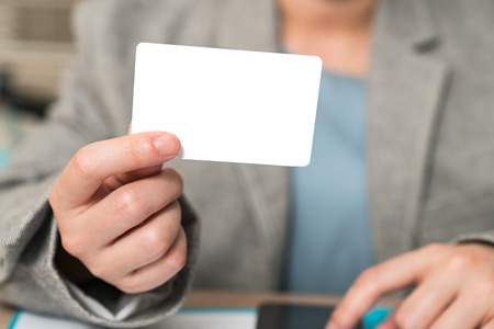 Businessmen show Blank business cards Business woman in a suit Stock Photo