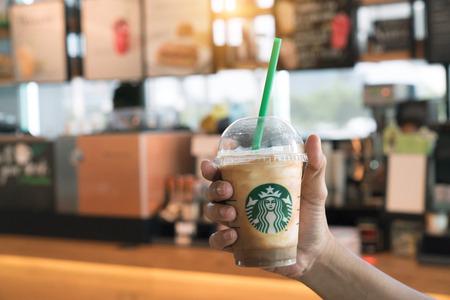 Bangkok Thailand - November 3-2017: Holds a cup of ventra of Granola frappuccino dark mocha at Starbucks coffee shop.