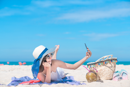 Holiday Vacation Smart Photo Self-Portrait With Selfie Asian Girls Getting Fun With Mobile Photography with Smartphones for Social Media in Summer Travel at the Beach