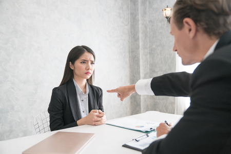 Wrathful company leader pointing guilty female employee on exit and asking to leave, scared of dismissal millennial woman begging angry boss not to fire her. Hiring manager refusing candidate in job