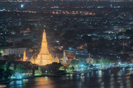 Wat Arun Temple at sunset in bangkok Thailand. Wat Arun is a Buddhist temple in Bangkok Yai district of Bangkok, Thailand, Wat Arun is among the best known of Thailands landmarks Stock Photo