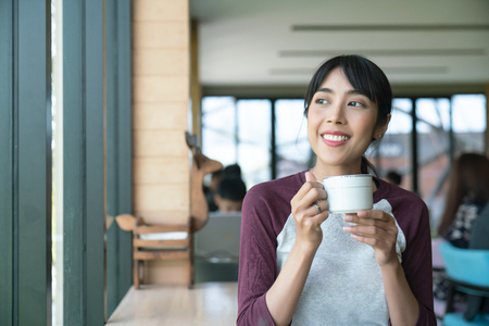 Coffee. Beautiful Girl Drinking Tea or Coffee in Cafe. Beauty Model Woman with the Cup of Hot Beverage.