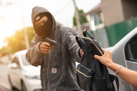 Men thiefs stealing young woman