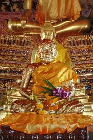 samutprakarn: Monk Statue Covered with Gold Leaves