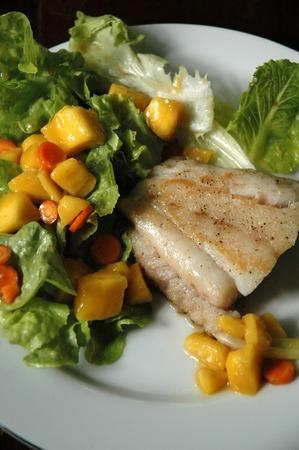 mango fish: Fish Steak with Ripe Mango Salad Stock Photo