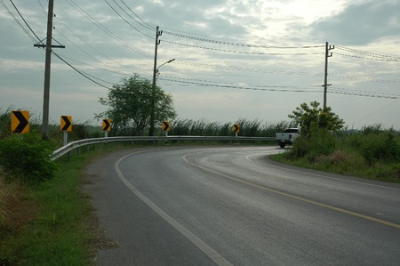 get away: Winding Country Road in the Morning Stock Photo