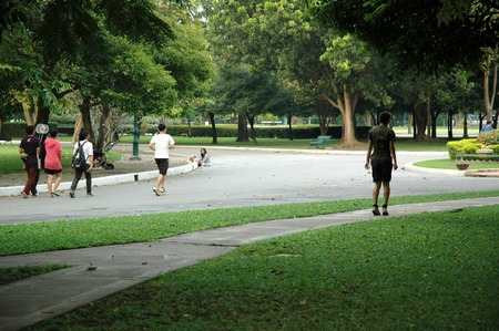 Nakhon Pathom, Thailand - November 11, 2013: People come to relax and exercise in the park which is in the area of Sanam Chandra Palace.