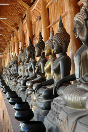 alms: Buddha Images with Monks Alms Bowls Stock Photo
