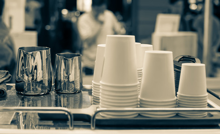 Cups of different sizes on cafe
