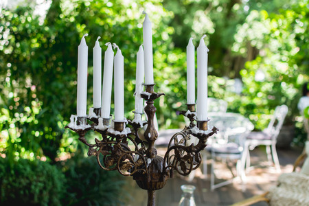 candlestick: Vintage bronze candlestick with white candles