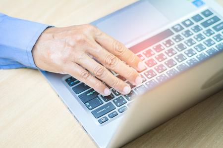 Asian businessman working on his laptop. Digital Economy.