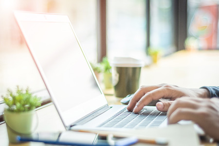 Asian young businessman working on his laptop. Digital Economy. 版權商用圖片