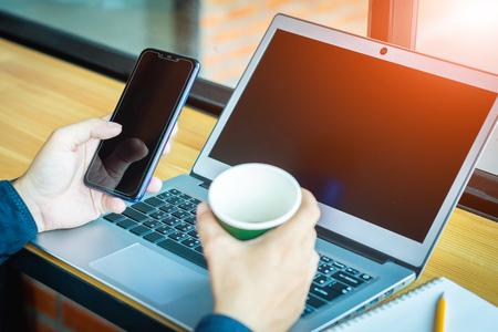 Asian young businessman working on his laptop. Digital Economy. 版權商用圖片 - 122951871