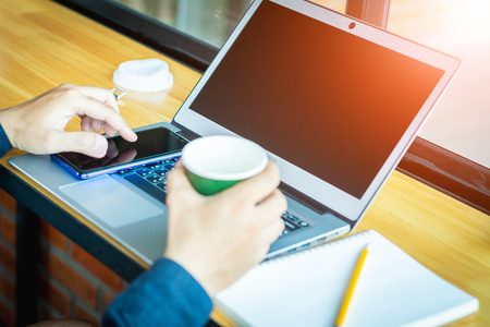 Asian young businessman working on his laptop. Digital Economy. 版權商用圖片 - 122951874