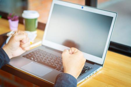 Asian young businessman working on his laptop. Digital Economy. 版權商用圖片 - 122951876