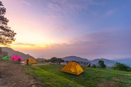 Camping orange tent at National Park in Northern,Thailand. 版權商用圖片 - 135982552