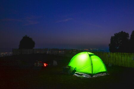 Camping green tent at National Park in Northern,Thailand.