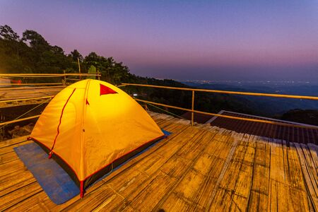 Camping orange tent at National Park in Northern,Thailand. Imagens - 140938058