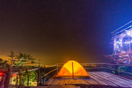 Camping orange tent at National Park in Northern,Thailand. Imagens - 140938482