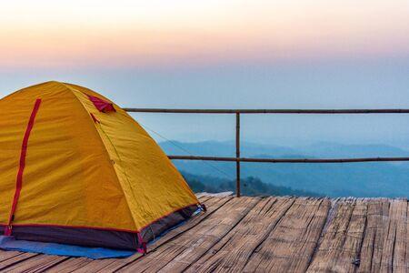 Camping orange tent at National Park in Northern,Thailand. 版權商用圖片 - 140870880