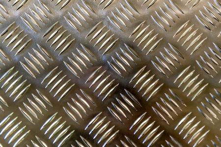 imposed: Metallic plate with a grid imposed pattern for gripping