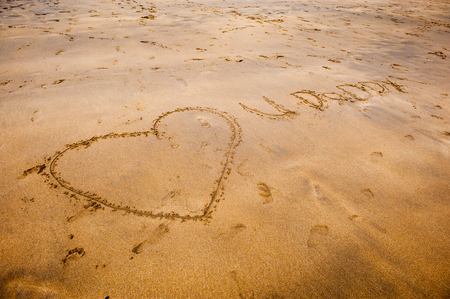 i love u: I love u daddy in writing in the sand on the beach Stock Photo