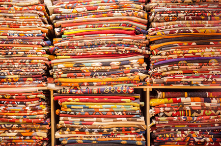 stock photographs: A large selction of blankets and their patterns on a shelf