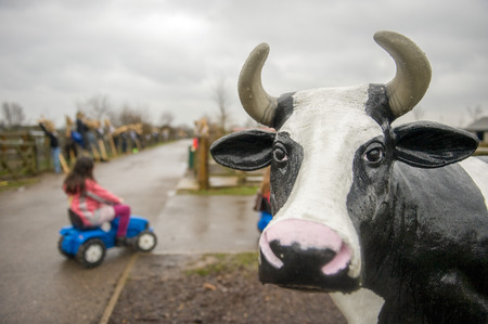 black and white farm: Plastic cow statue at farm fair Stock Photo
