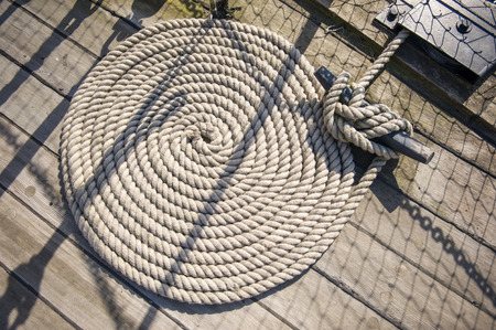 ship deck: Shipping rope on a ship deck laid in a circle