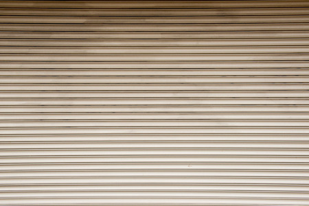 straight lines: Straight lines on a shop front shutter Stock Photo