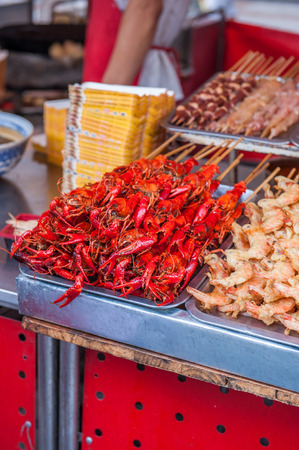 crustaceans: Large red claws of crustaceans on market stall in China